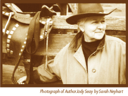 Author Jody Seay with Cowgirl hat and saddle